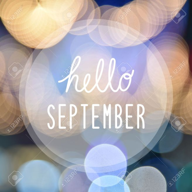Hello September greeting on bokeh lights