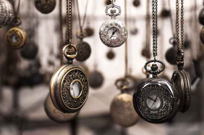 assorted silver colored pocket watch lot selective focus photo