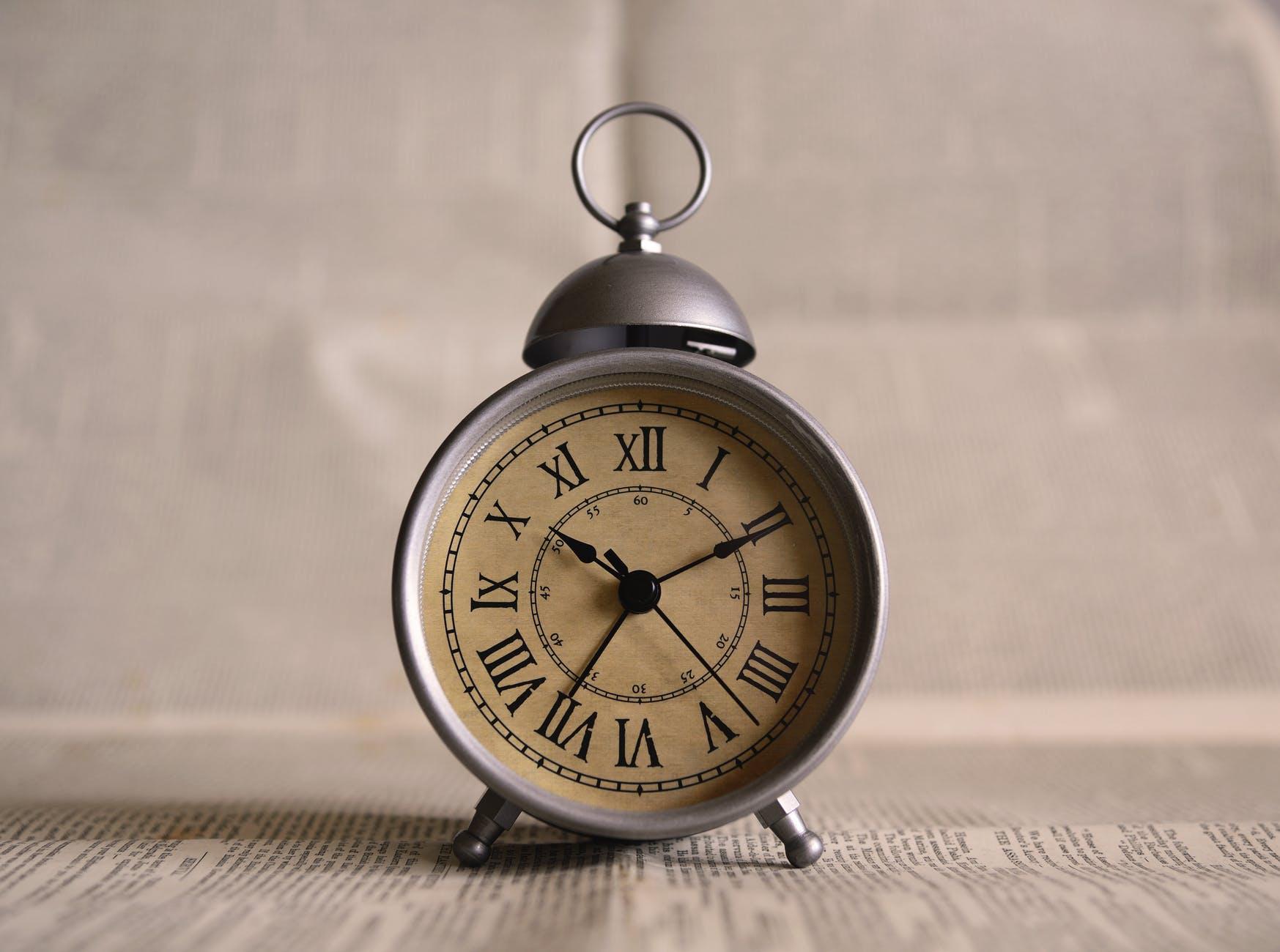 aged alarm clock antique background
